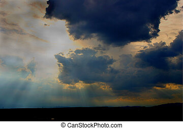 clouds 3993 - Sunlight streaming down through clouds in the...