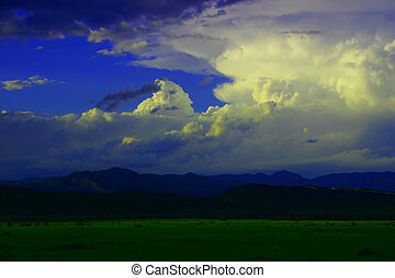 Approaching Storm - Storm approaching over mountains casts...