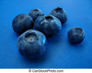 Blueberries II - Macro of fresh blueberries on a blue...