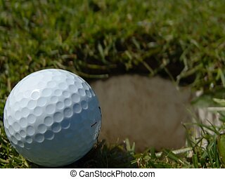 On the Edge (2) - Horizontal shot of golfball laying on the...