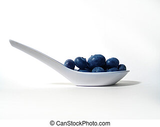 Blueberry Scoop - Fresh blueberries in a small white plastic...