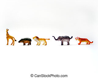 Toy Animals - 5 toy animals in a row on a white background.
