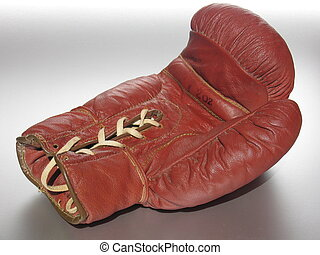 Lying Boxing Glove - Used boxing glove lying on the...