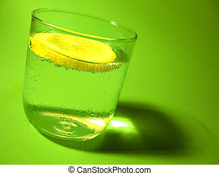 Lemon Water 2 - A glass of carbonated water with a lemon...
