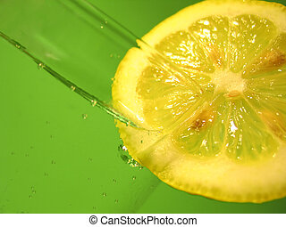 Lemon Water 3 - A glass of carbonated water with a lemon...
