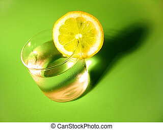 Lemon Water 4 - A glass of carbonated water with a lemon...