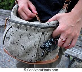 Hands closing a bag