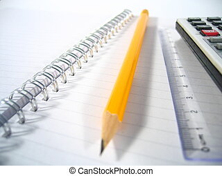 Writing Pad I - A writing pad with a ruler, a pencil and a...