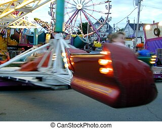 whip on by - photo of a carnival ride as the car whipped on...
