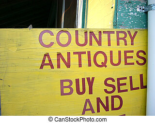 """Buy And Sell - Aged yellow """"Buy & Sell"""" sign for a country..."""