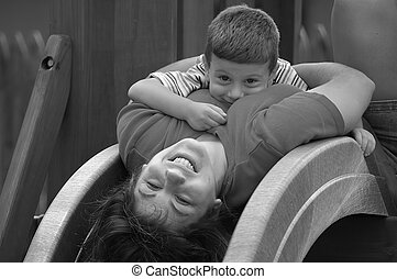 Playtime - Photo of Mother and Toddler on Slide in Black and...