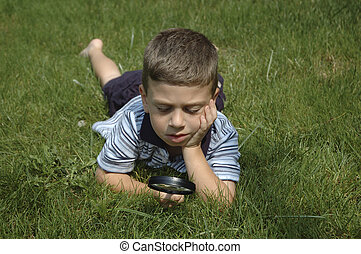 Observing Nature 2 - Photo of Child Using Magnifying Glass...