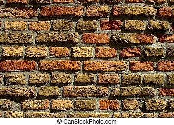 Brickwall of handcute stones of old church