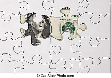 Uncovered Money - Photo of Puzzle With Money Showing Through...