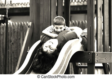 Playtime - Photo of Mother and Child on Slide in Black and...