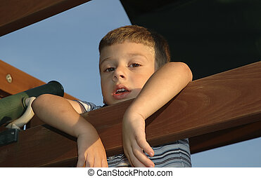 Young Boy - Photo of Young Boy Hanging On Playset.