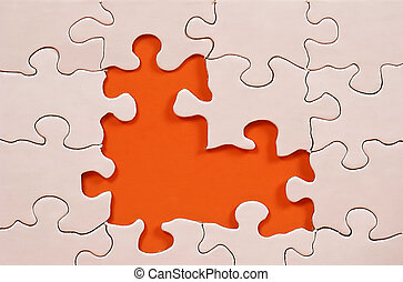 Puzzle Frame - Photo of a Puzzle With Orange in Background