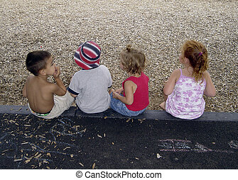 Little Rascals - Photo of 4 Kids Sitting on Curb