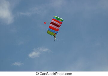 Up in the Air - Weekend thrill seeker parachuting over...
