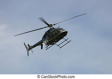 Helicopter flying over airport in southern Colorado
