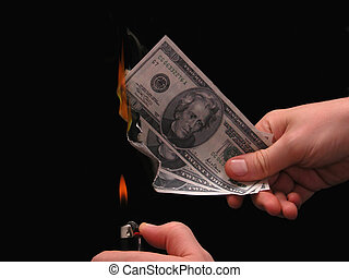 Money To Burn - Metaphor: Money to burn. Hand holding a...