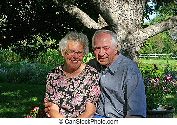 Elderly Couple - An elderly couple posing in their backyard.
