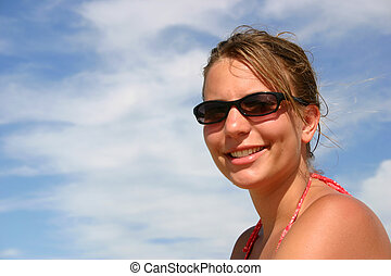Shades and Sky - A young woman wearing sunglasses