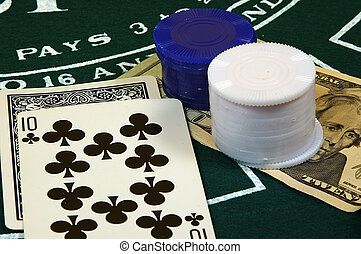 Gamble - Photo of Cards, Chips and Money on Black Jack Table...