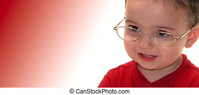Smart Boy - Todder boy in eye glasses with a smile looking...