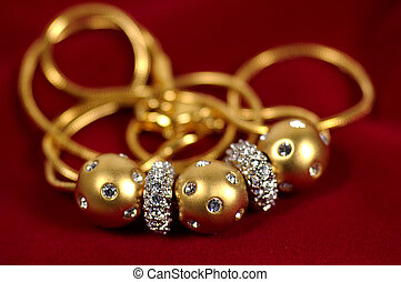 Necklace - Photo of Gold Balls With Diamonds on a Necklace