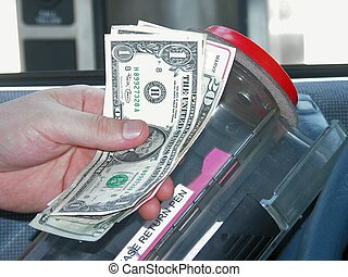Drive Up Bank - Man's hand placing a cash deposit into the...
