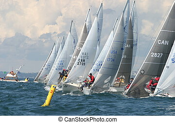 Reaching the line - J24 sailors reach on the start line at...