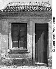 weathered house - A small very weatherd house in a small...