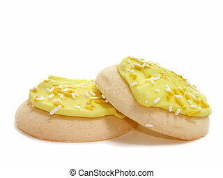 Lemon Cookies v3 - Side view of two lemon frosted & sprinkle...