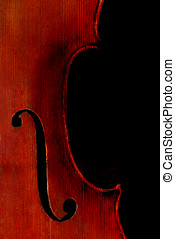 Cello - A full sized cello isolated on black.