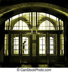 Door Entry - A man is entering a very old building through...