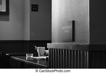 smoker - smoking area of a coffee shop