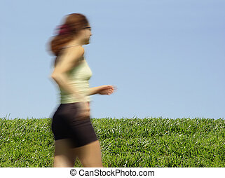 Girl running - Young woman running through the field