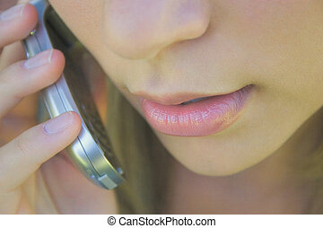Calling - A young woman on a cell phone.