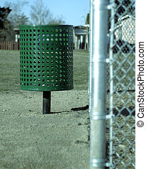 Garbage Can - A garbage can near a baseball field