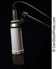 Studio Mic v2 - Studio mic hanging from mic stand against...