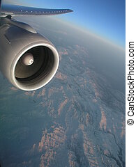 777 over mnts - 777's massive GE power plant lit by morning...