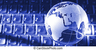 gate to the world - glass globe on a keyboard