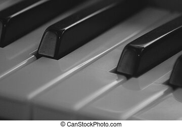 Piano Keys - A closeup of some piano keys. The image is...