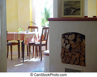 room with stove - tables and fireplace in a small restaurant