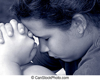 Girl in Prayer - BW closeup of a young teen girls face and...