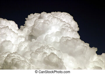 Thunderhead - Cumulus clouds billowing up to form...
