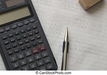 Homework - Calculator, pencil, and eraser on math problems.