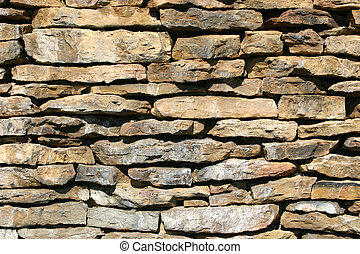 Rock wall - A lovely piece of landscaping using this natural...