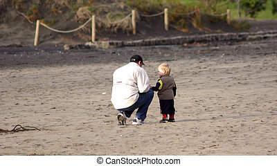 Father and son - Dad spending time with baby son on the...